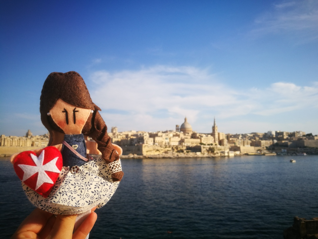 Sliema - Maltese doll and view of La Valletta